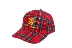 Red tartan cap with scottish arms Stock Photos
