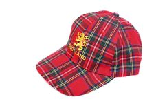 Red tartan cap with scottish arms Royalty Free Stock Photo