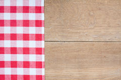 Red tartan cloth on wood Stock Photography
