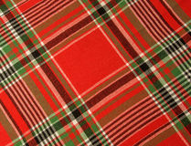 Red tartan fabric. Red tartan fabric as background (red, black, green and white Royalty Free Stock Photography
