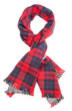 Red tartan scarf. Wool red tartan plaid scarf isolated on white background. File contains a clipping path Royalty Free Stock Images