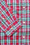 Red tartan shirt. Close up of the front of a casual red tartan shirt Stock Photos