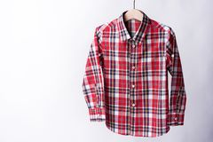 Red tartan shirt folded on white background.  Stock Photography