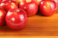 Red tasty apples on wooden table Stock Image