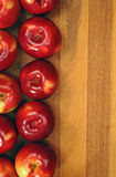 Red tasty apples on wooden table Royalty Free Stock Photos