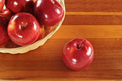 Red tasty apples on wooden table. Red tasty apples on a wooden table Royalty Free Stock Images