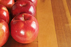Red tasty apples on wooden table. Red tasty apples on a wooden table Royalty Free Stock Image