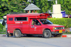 Red taxi for chiangmai city. Thai call song taew Stock Photos