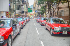 Red Taxi. Queue in a straight line stock photography