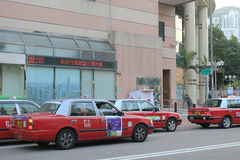 Red taxi station in hong kong Stock Photos