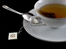 Red Tea. A cup of red tea with black background stock photos