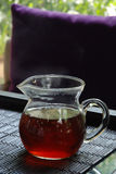 Red tea. Glass of red tea standing on the table Royalty Free Stock Photography