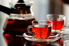 Red Tea. Prepared in teapot and teacups Stock Photography
