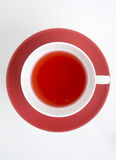Red tea. Rosehip(red) tea in a white cup on red saucer Stock Photo
