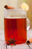 Red tea with cinnamon sticks Royalty Free Stock Photography