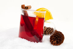 Red tea with cinnamon sticks and orange Stock Photo
