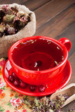 Red tea cup, healing herbs Stock Photo