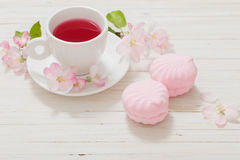 Red tea with flowers on  wooden background Royalty Free Stock Photo