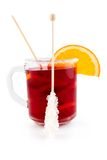 Red tea fruit. Glass cup of red tea with orange and sugar stick on a white background Stock Photography