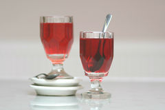 Red tea in glass still life . Pair of vintage facet cut glasses with red tea Royalty Free Stock Photos