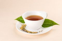 Red tea with green leaf Stock Photo