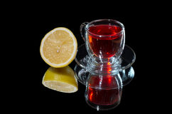 Red tea and lemon with reflection Stock Photo