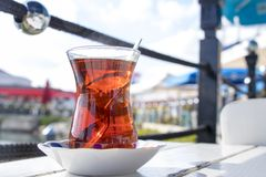 Red tea on the light table with life background stock photo