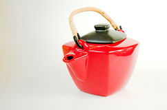 Red tea pot. Ceramic red tea pot with black lid isolated on white Stock Image