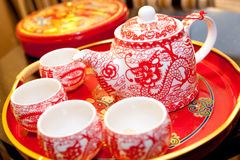 Red tea pot in wedding. A set of red tea pot and cup ; tradition in chinese wedding; a pattern of dragon and 'love&#x27 Stock Photography