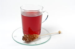 Red tea and rock candy Royalty Free Stock Image