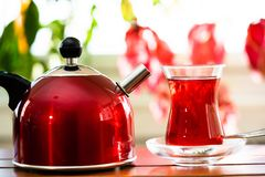Tea in small cup on table royalty free stock image