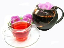 Red tea with wild rose flowers Royalty Free Stock Photo