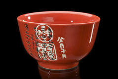 Red teacup. Red chinese teacup with hieroglyphs Stock Photography