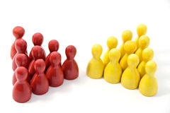 Red Team Meets Yellow Team. Colored wooden markers on a white background. Red team meets the yellow team stock images