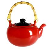 Red teapot with a bamboo handle. Isolated on white Stock Photography