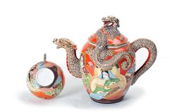 Red teapot with cup 2. Antique red teapot with dragon and one cup Royalty Free Stock Photo