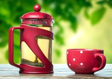 Red teapot and cup with tea Stock Photos