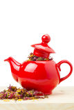 Red teapot with healing herb Stock Images