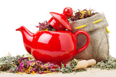 Red teapot, sack with healing herbs Stock Photo