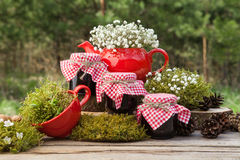 Red teapot, tea cup and three jars of  healthy jam. Royalty Free Stock Photo