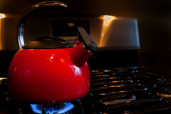 Red Teapot warming Stock Photo
