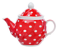 Red teapot with white polka dots. Red teapot with white polka dots on a white background Stock Photo