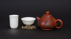 Red teapot and white tea cups Royalty Free Stock Image