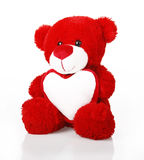 Red teddy bear with heart. On a white background royalty free stock photography