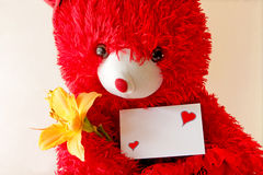 Red teddy bear holding a note Stock Photo