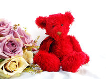 Red teddy bear with tulip artificial flowers Royalty Free Stock Photos