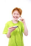 Red teen happy. Red teen listens to music. The white background isolated Stock Photography