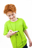 Red teen listens to music. The white background isolated Stock Photography