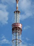 Red telecommunication pylone, blue sky Stock Image