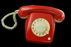 Red telephone. Old red telephone on black Royalty Free Stock Photos